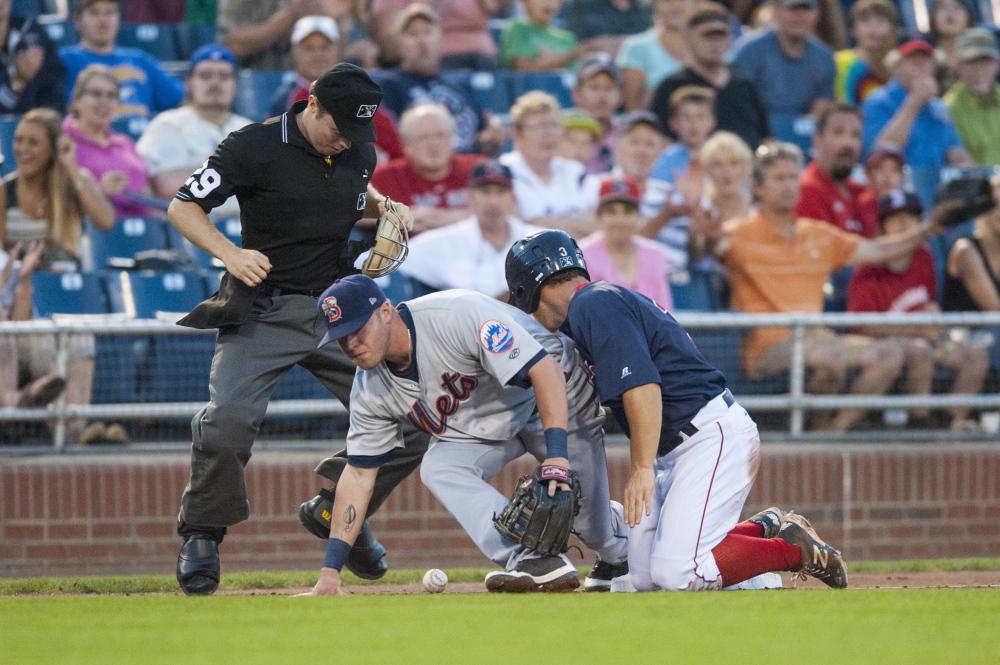 Portland' Sean Coyle slides safely into Binghamton Mets' third baseman Dustin Lawley in the fourth inning. Logan Werlinger/Staff Photographer