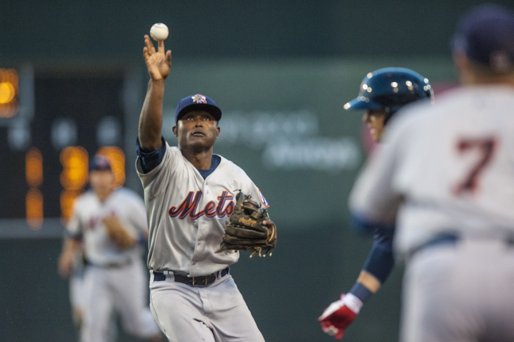 Binghamtom Mets' second baseman Dilson Herrera makes a throw during a run down involving Portland's Shannon Wilkerson in the fourth inning Tuesday at Hadlock Field.
