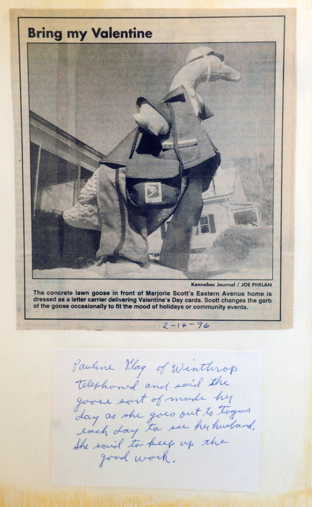 Marjorie Scott has a scrap book for the concrete goose in front of her Eastern Avenue home in Augusta. She has been dressing it up for 20 years. This 1996 photo shows a Postal Service letter carrier outfit for Valentine's Day.