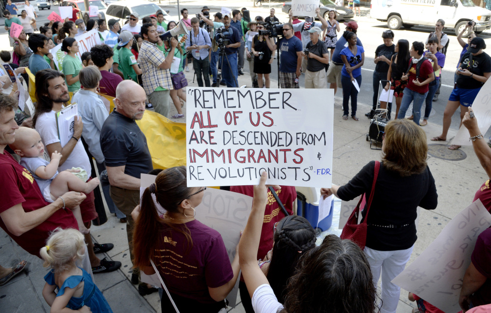 Pro-immigrant activists participate in a counter-protest against a group of tea party members staging a rally against the surge in illegal immigration on July 18 in Philadelphia, Pa.