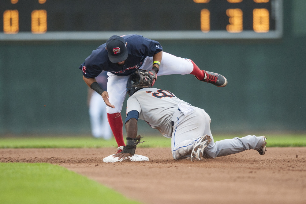 Portland shortstop Ryan Dent attempts to tag Binghamton's Dilson Herrera on a stolen base in the fifth inning of the Mets' 4-2 victory at Hadlock Field on Wednesday.
