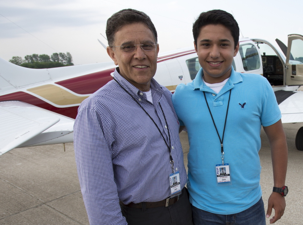 Babar Suleman and son Haris Suleman, 17, stand next to their plane June 19 at an airport in Greenwood, Ind.