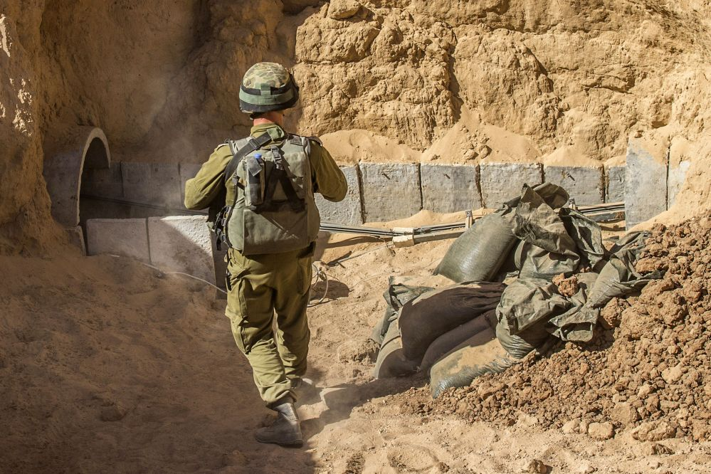 An Israeli army officer on Friday walks near the entrance of a tunnel that is allegedly used by Palestinian militants for cross-border attacks, at the Israel-Gaza border. The tunnel network is taking center stage in the latest war between Hamas and Israel.