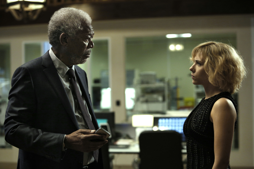 This image released by Universal Pictures shows Morgan Freeman, left, and Scarlett Johansson in a scene from