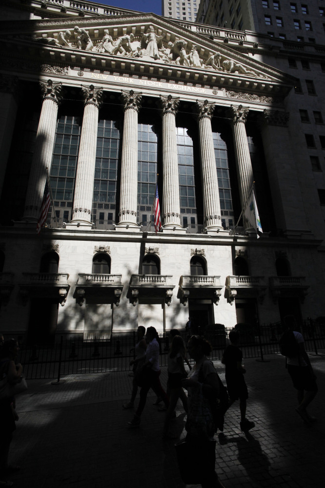 The New York Stock Exchange is shown. European stock markets were down Friday, while Asian markets took cheer from U.S. unemployment claims falling to an eight-year low.