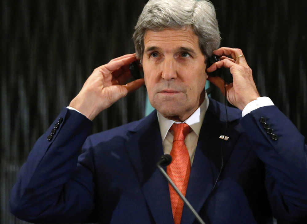 U.S. Secretary of State John Kerry listens to remarks Friday at a hotel in Cairo. The lull in fighting will allow civilians to receive aid and evacuate to safer areas, a spokesman for Hamas says.
