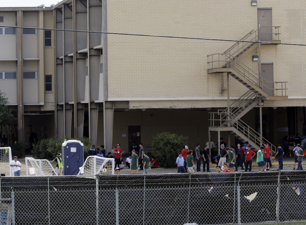 Unaccompanied minors who have entered the country illegally are being held at temporary shelters such as this one at Lackland Air Force Base in Texas. With Congress about to recess, chances for a long-term solution seem improbable.