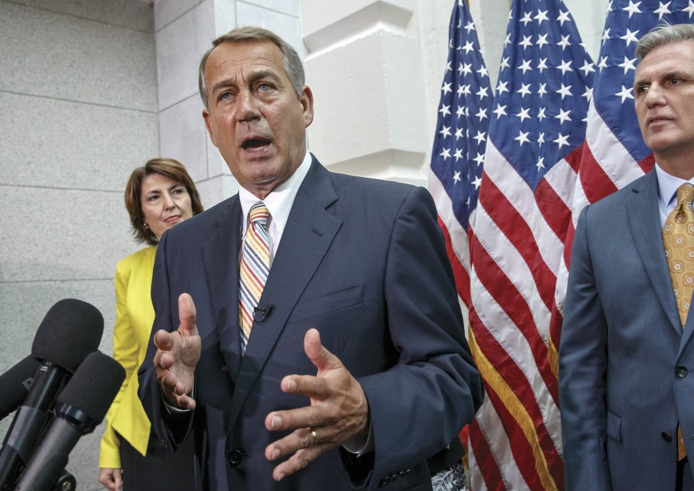 Speaker of the House John Boehner of Ohio, flanked by Rep. Cathy McMorris Rodgers, R-Wash., and incoming Majority Leader Rep. Kevin McCarthy, R-Calif., speaks to reporters on Capitol Hill Tuesday following a Republican strategy session.