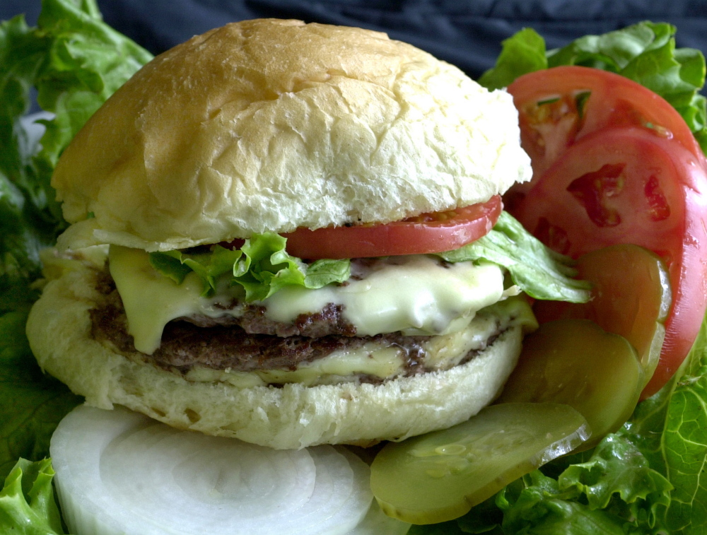 New studies of the diets of thousands of people in the United States, Canada and the United Kingdom found that if they reduce the amount of meat they eat, like the cheeseburger pictured here, it will help to lower greenhouse gas emissions.