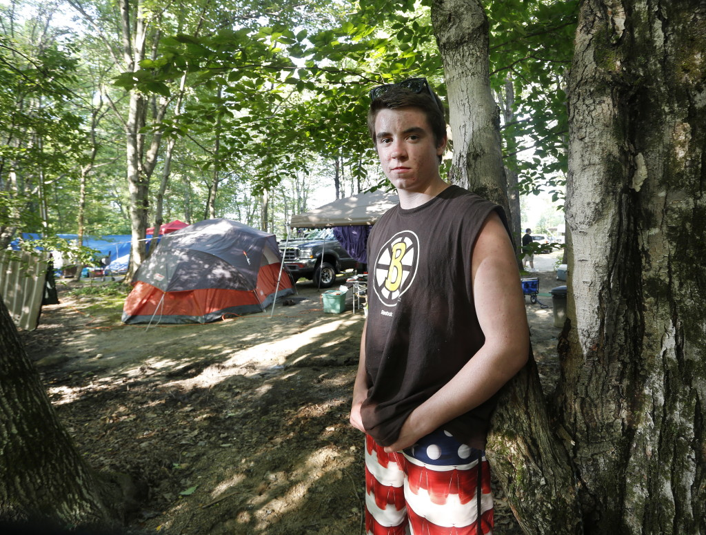 "Sean Greeley, 16, of Walpole, Massachusetts, says he was sitting at his campsite at the Four Seasons Campground in Naples on Monday when lightning struck this nearby tree, and then him. ""It felt like someone picked me up and shook me,"" he said."