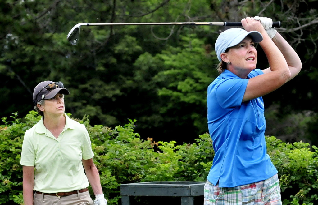 Leslie Guenther, right, had a tough day Wednesday after a strong day Tuesday but in the end came away with the Maine Women's Amateur championship at the Waterville Country Club. Mary Brandes, left, finished second. David Leaming/Staff Photographer