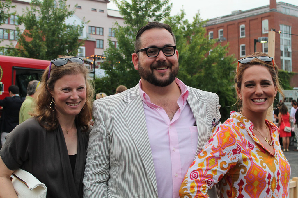 """Molly Meyer, Sean Wilkinson and MaryBeth Lorenz, members of The Contemporaries Steering Committee, take in the festivities at """"Summer in the City,"""" the group's annual midsummer bash."""