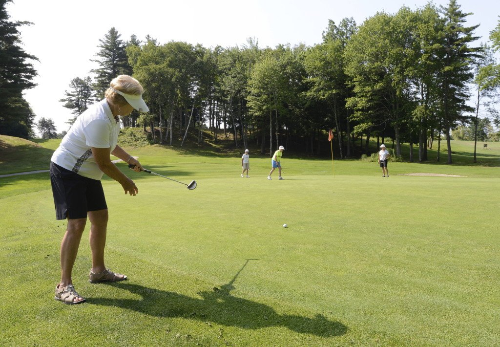 Nancy Caprio of Portland watches a putt drop on the third hole at Riverside. Caprio is part of an active membership at the public course.