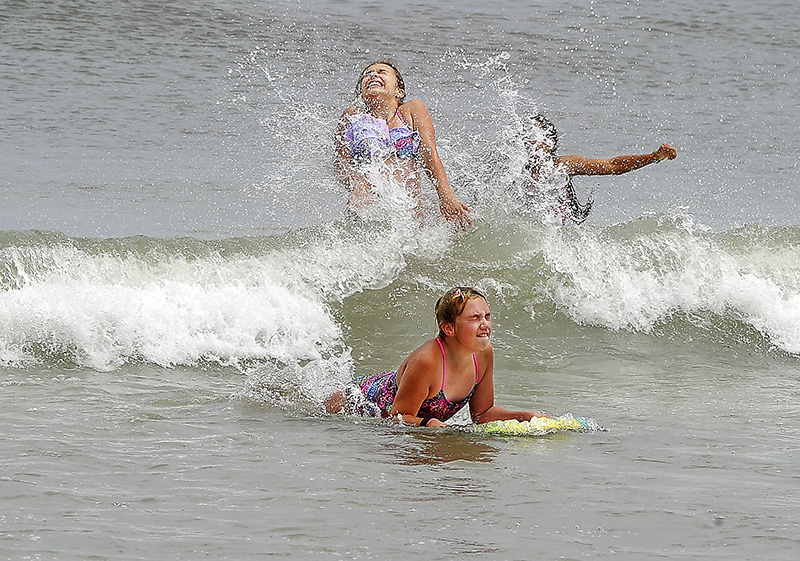 JULY 05: Young visitors to Old Orchard Beach enjoy the waves as the fear from riptides was aleviated by officials. Gordon Chibroski/Staff Photographer