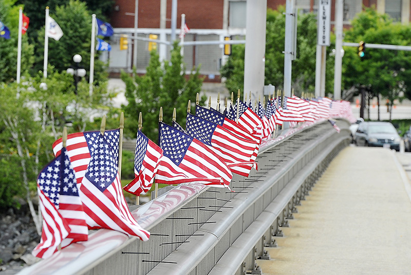 American flags wave strongly over the bridge in Lewiston as the wind picks up from the remenants of Hurricne Arthur. Gordon Chibroski/Staff Photographer