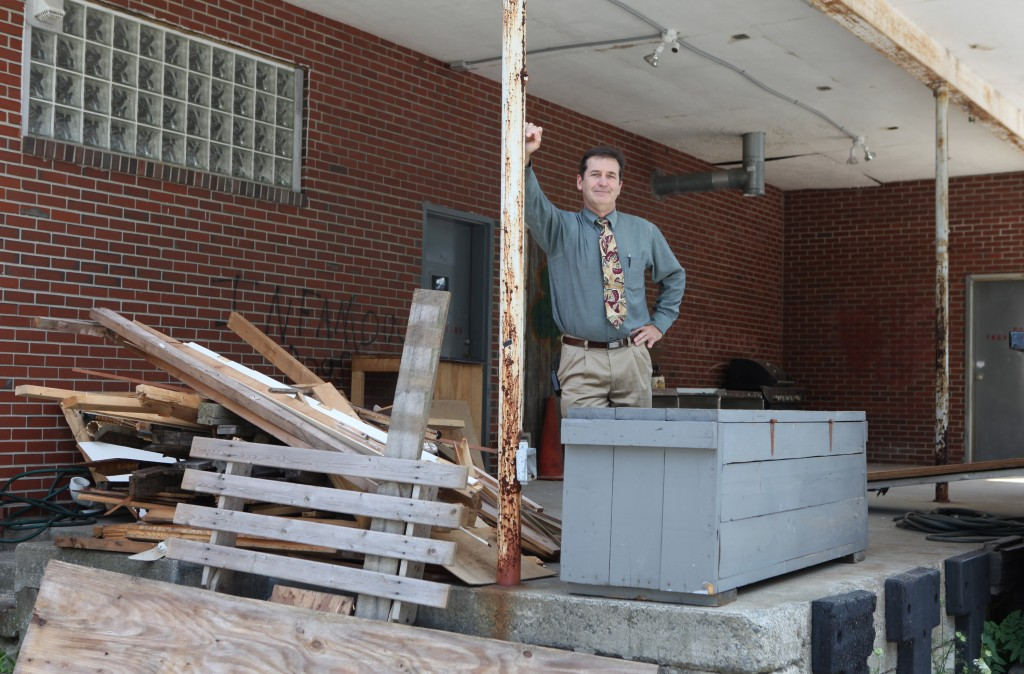 Pierre Bouthiller poses Monday outside the former post office in Old Orchard Beach where he is proposing a facility for four licensed caregivers to grow marijuana. The Town Council voted Tuesday to temporarily ban any growing of medical marijuana in a commercial setting.
