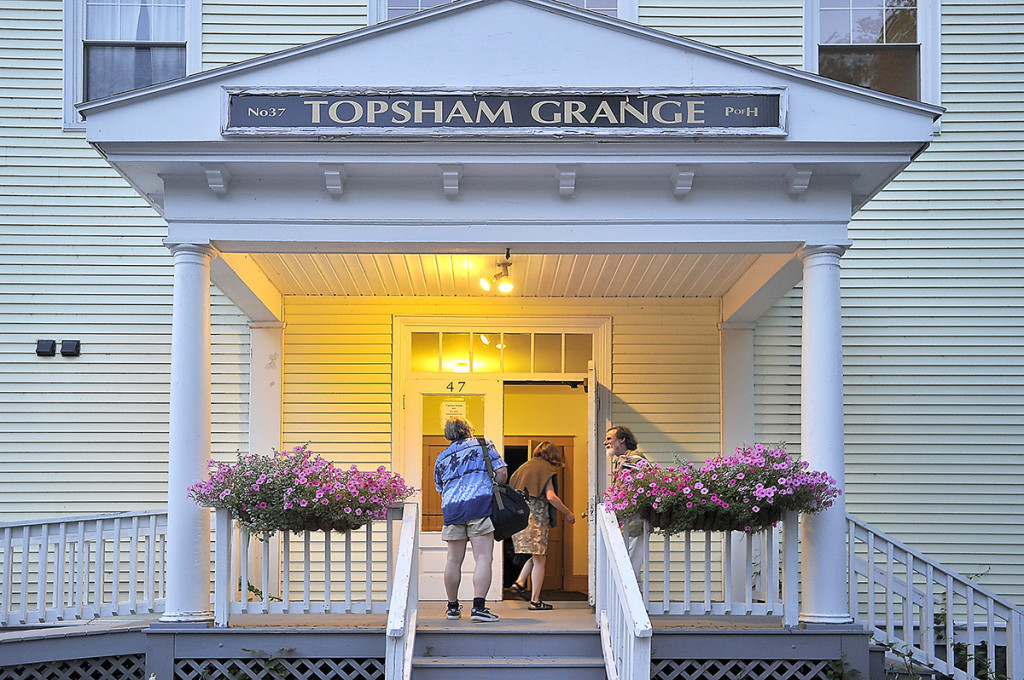 People arrive at the Topsham Grange to enjoy a square dance gathering called (Put Your) Hoe Down: A Raucous Square Dance Party.