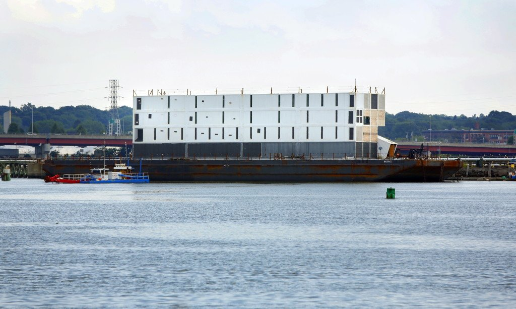 "Google's barge, carrying a still-mysterious four-story structure, was hauled by tugboat from Portland to South Portland on Wednesday to be prepared for an ""ocean voyage."""