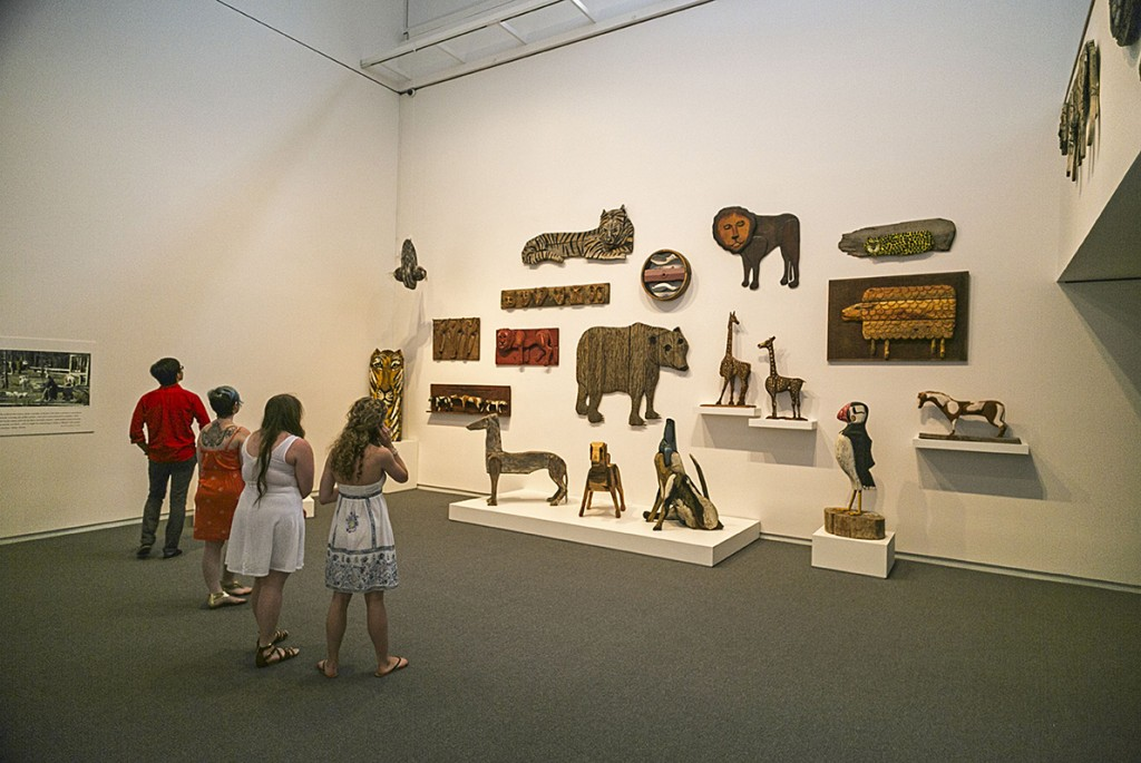 Visitors to the Colby College Museum of Art view the Bernard Langlais Retrospective.