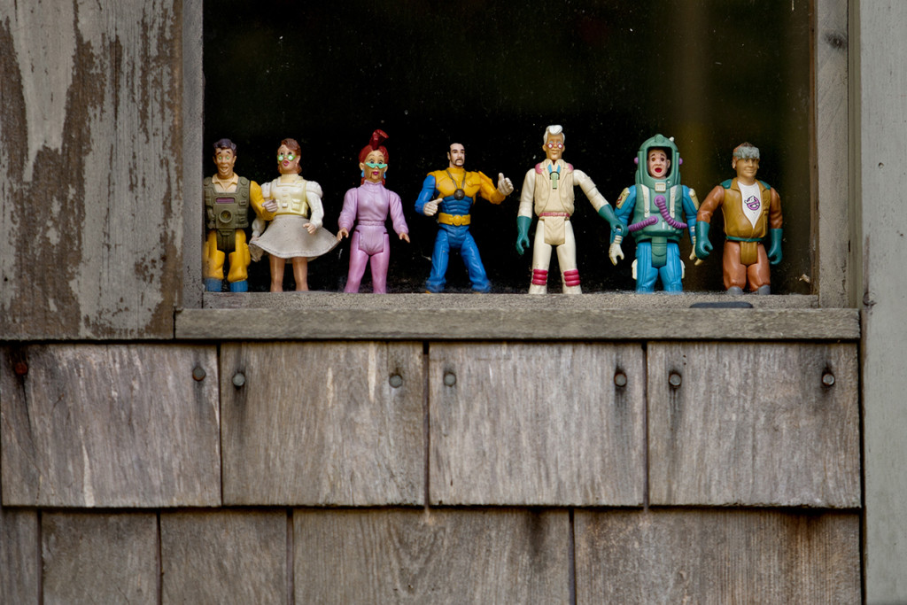 The front window of artist Bryan's home is decorated with action figures.
