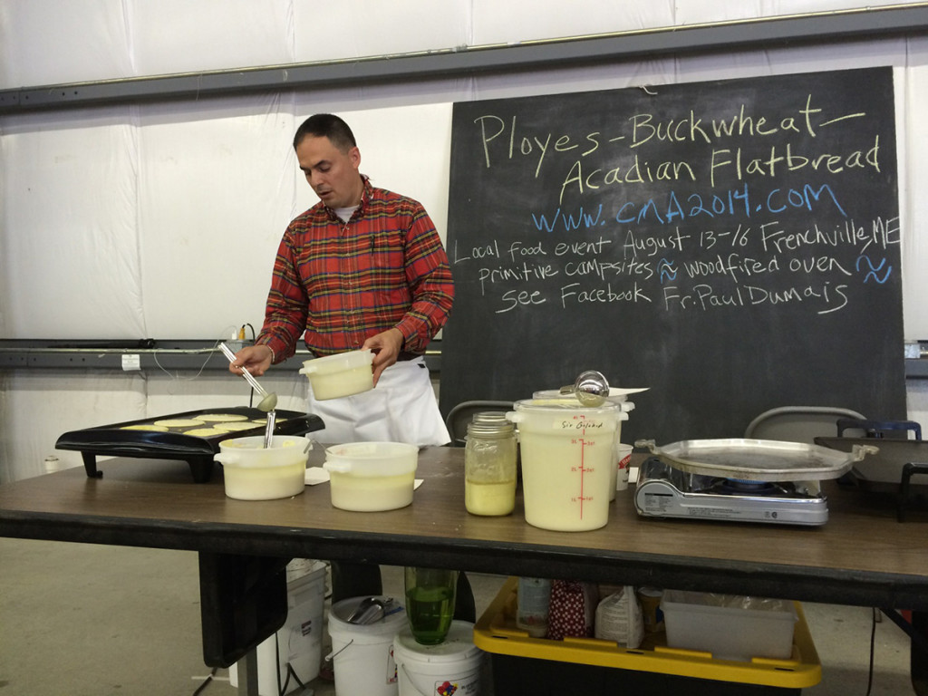 "The Rev. Paul Dumais demonstrates making ployes at the Kneading Conference in Skowhegan. He makes an ""authentic"" ploy with a starter he developed himself."