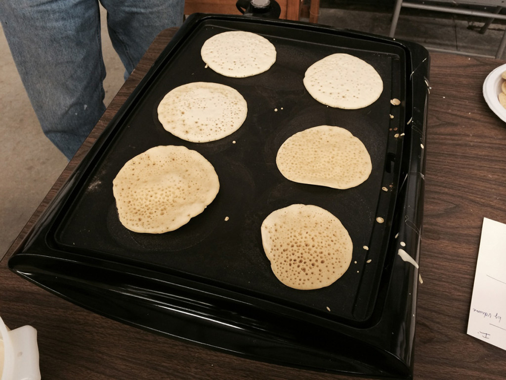 Ployes cook on a griddle during the Kneading Conference in Skowhegan.