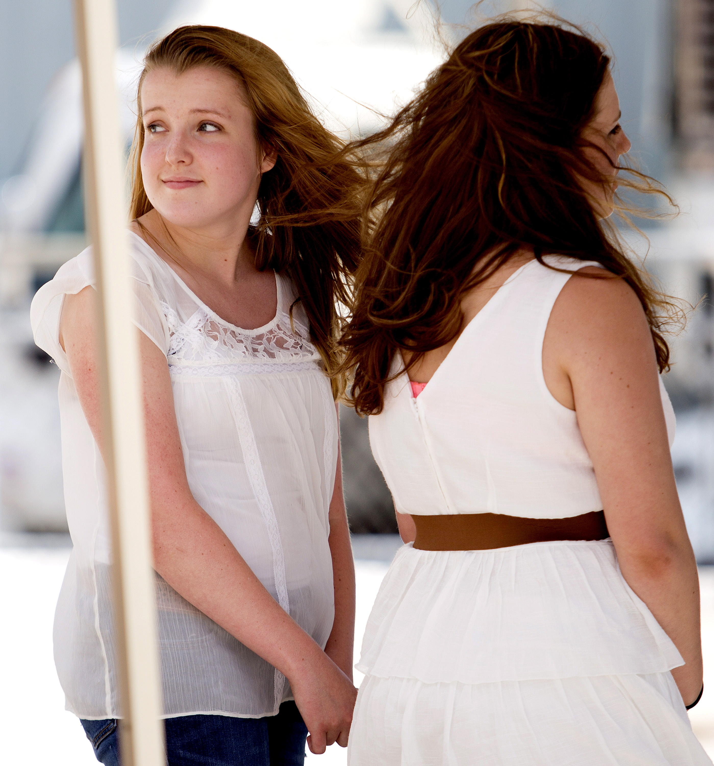 """Abigail Day, 17, of Cornish, looks back toward her mother after auditioning for """"American Idol"""" on the Maine State Pier in Portland on Wednesday."""