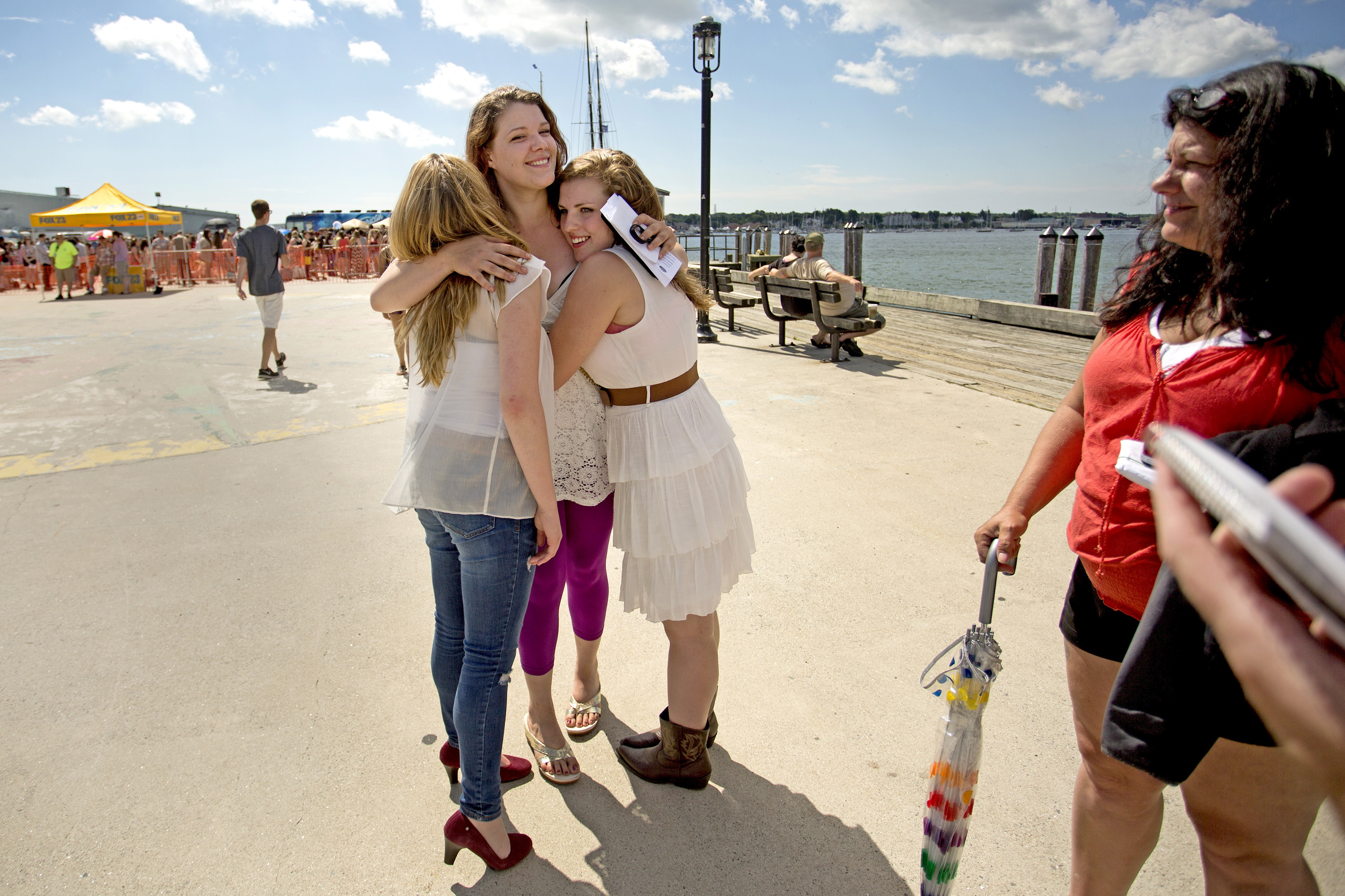 """Abigail Day, 17, of Cornish, left, Jaile Kane, 25, of Ellsworth, and Miranda Mastera, 16, of Hiram, embrace after the trio auditioned but didn't make the cut for """"American Idol"""" on the Maine State Pier in Portland on Wednesday."""