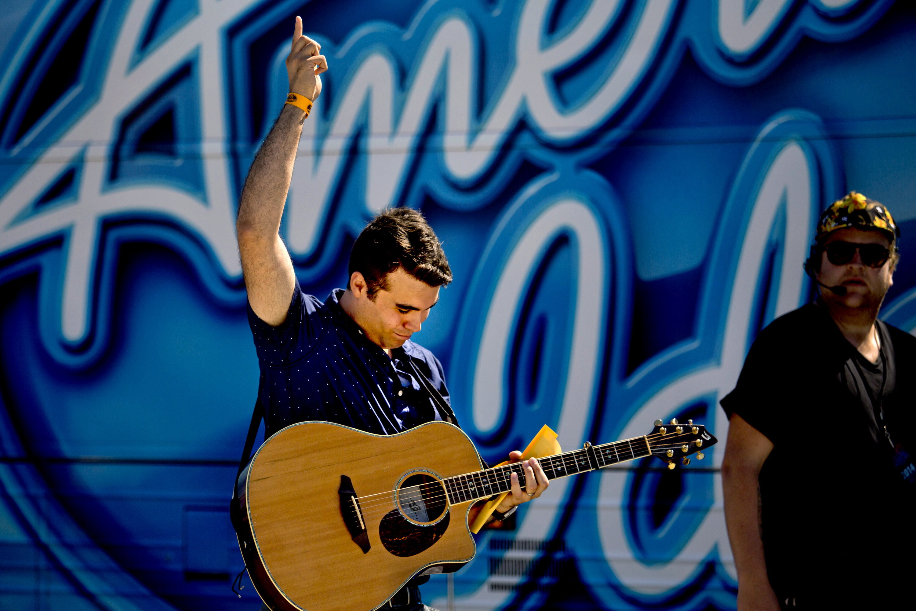 """Tom Emerson, 26, of Wells, celebrates after he made the first cut at auditions at the """"American Idol"""" bus on the Maine State Pier in Portland on Wednesday."""