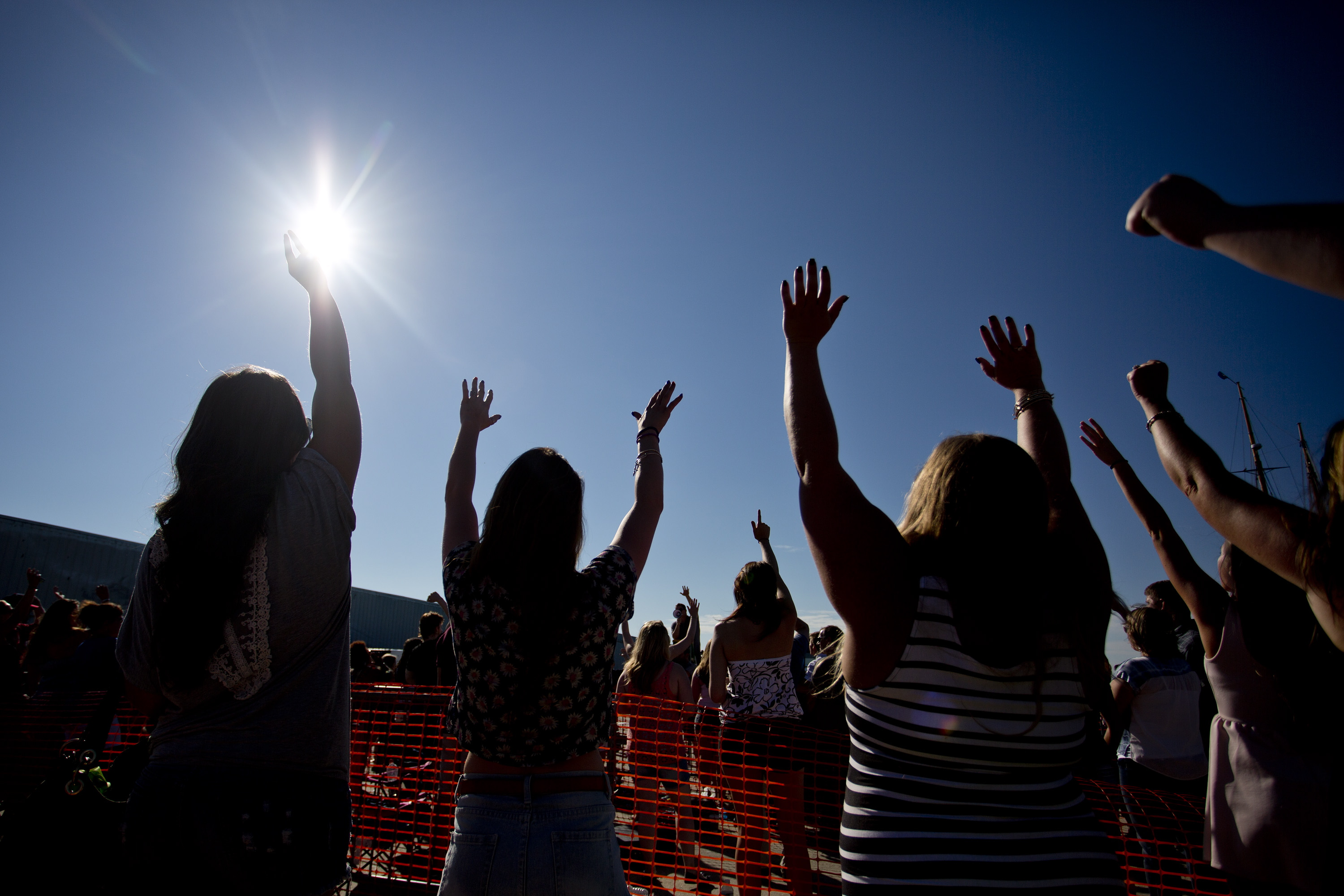 Fans cheer as they wait in line to tryout for American Idol at the Maine State Pier.