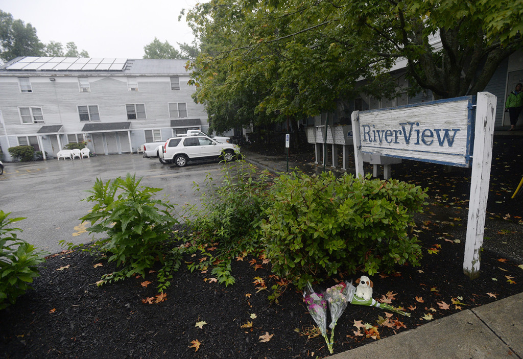 Rain falls Monday at RiverView Apartments in Saco where an investigation continues into the deaths of a family of five, including three children. Shawn Patrick Ouellette/Staff Photographer