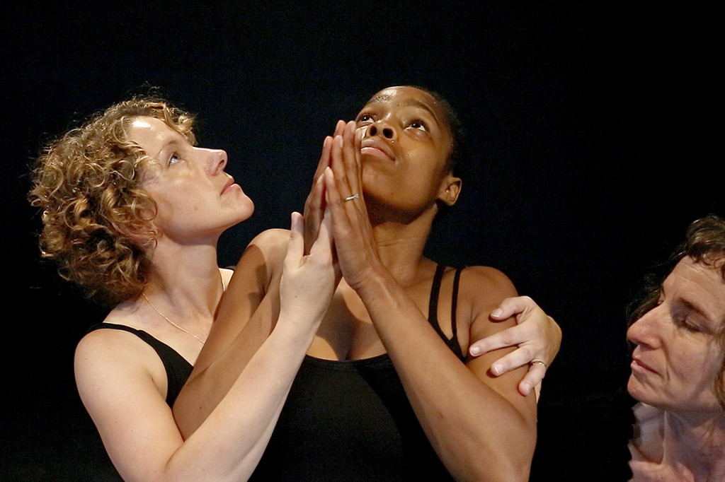 """Michelle Meyer, left, of Boston, and Nettie Johnson, at right, of Brattleboro, Vt., support Rene Johnson as the trio acts out a physical theater scene based on the word """"Cathedral"""" during a morning session of a devising intensive workshop at the Celebration Barn Theater.  Johnson is the residential manager at the barn but also takes part in the classes."""