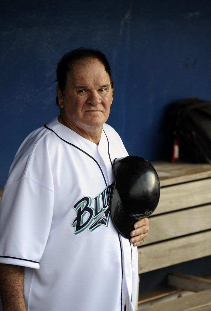 Pete Rose stands for the national anthem during a game on June 16 in Bridgeport, Connecticut. Rose, banned from Major League Baseball, managed the independent Bridgeport Bluefish for a day. Commissioner Bud Selig now says Rose could play a part in the ceremonies when the Cincinnati Reds host the 2015 All-Star game.