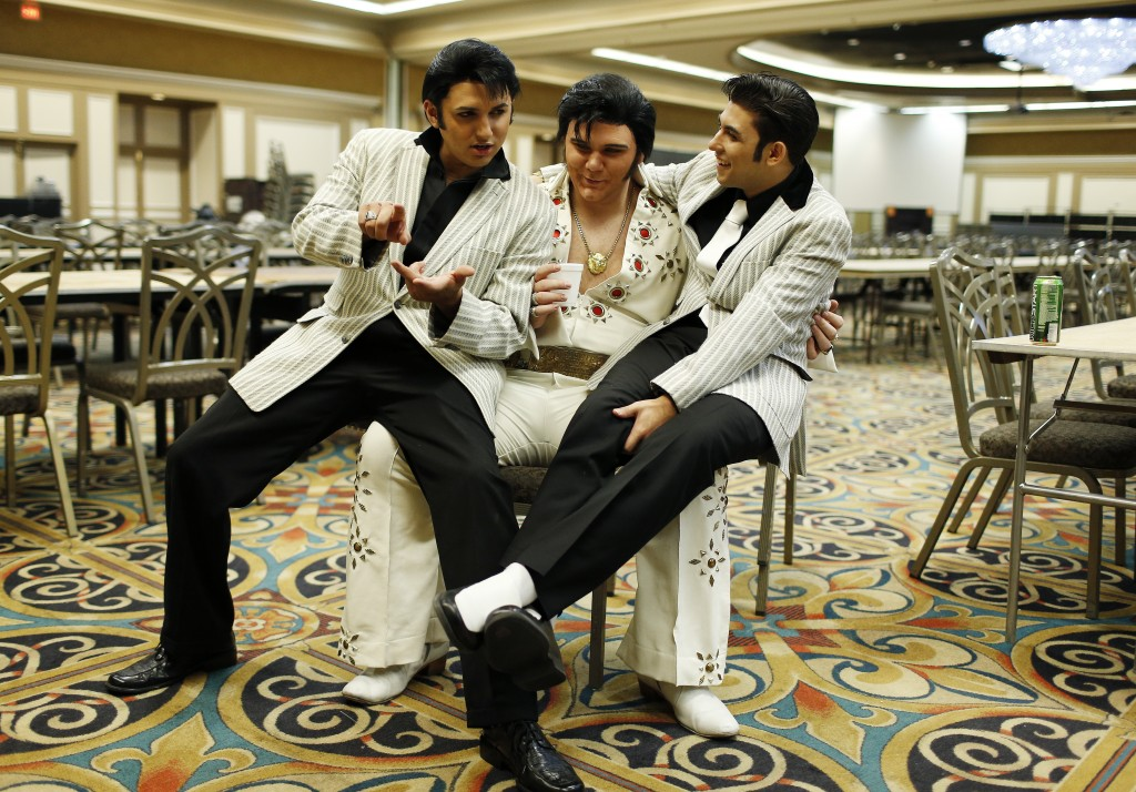 Daniel Jenkins, left, Tyler James and Jacob Roman joke around during the Las Vegas Elvis Festival. The three, along with other Elvis tribute artists, performed in a competition at the convention.