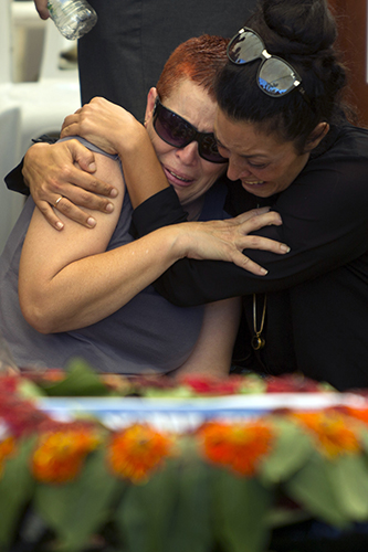 The mother, left, of Staff Sgt. Amit Yeori, 20, cries during his funeral at the Mount Herzel military cemetery in Jerusalem, Sunday. The Associated Press