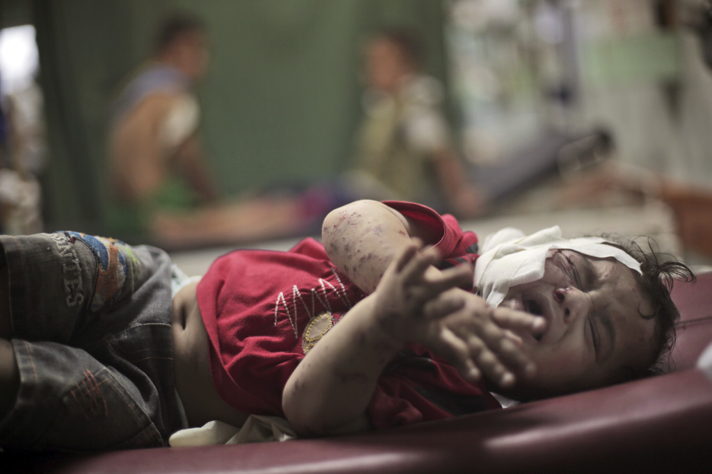 A Palestinian boy cries while receiving treatment at the Kamal Adwan hospital in Beit Lahiya for wounds caused by an Israeli strike at a U.N. school in Jebaliya refugee camp. The Associated Press