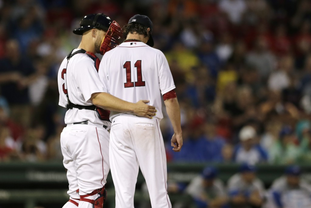 Red Sox starting pitcher Clay Buchholz  talks with catcher David Ross before giving up a two-run single to the Blue Jays' Ryan Goins during the fourth inning of a game at Fenway Monday. The Associated Press