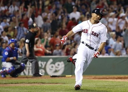 Red Sox center fielder Mookie Betts runs after hitting a two-run home run against the Chicago Cubs at Fenway Park in Boston on July 3. The Associated Press