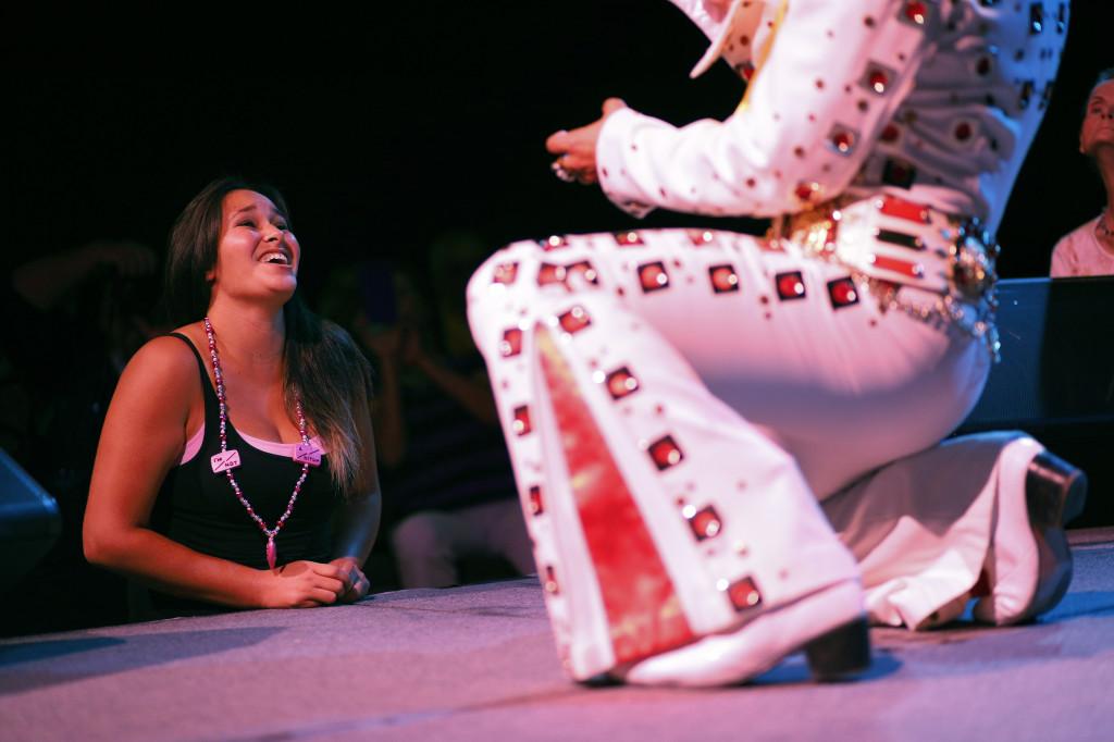 Yvonne Garcia, of Midland, Texas, watches an Elvis tribute artist perform during the Las Vegas Elvis Festival in Las Vegas.