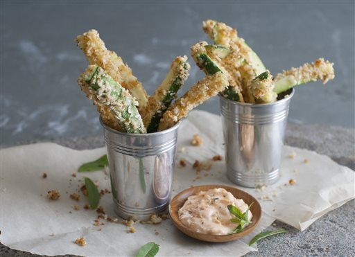 Cheesy zucchini fries with paprika dipping sauce. The Associated Press