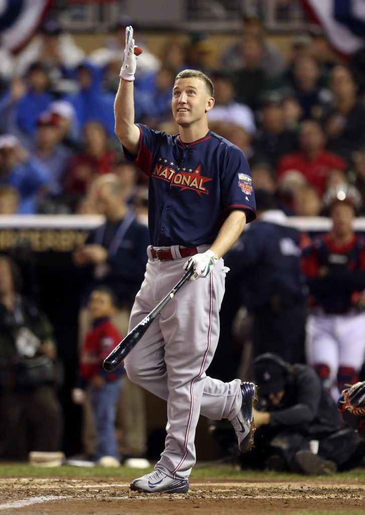 Todd Frazier of the Cincinnati Reds, a finalist in Monday's MLB All-Star baseball Home Run Derby, watches one of his hits.
