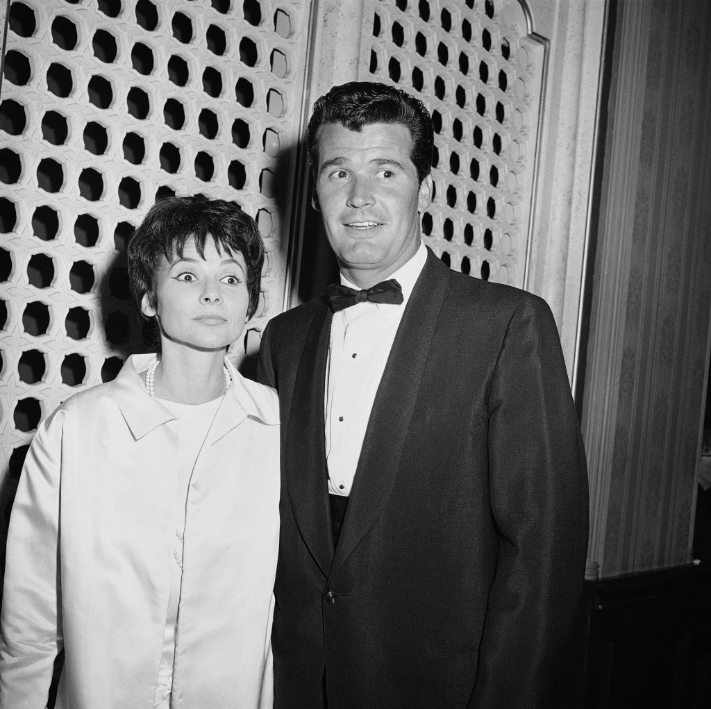 """Jim Garner of the TV program """"Maverick?""""arrives with his wife, Lois Clarke, at the Emmy Awards, in this April 15, 1958  photo. The Associated Press"""