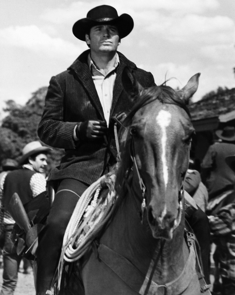 James Garner as Australia- bound Jason McCullough rides into gold-rush boom town of Calendar in this April 1968 photo taken at MGM Studios.  The Associated Press