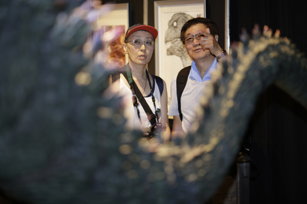 Japanese Godzilla devotees Yoshihiko Horie and his wife Shizue look at a scale model of Godzilla  at the Godzilla Expo in Tokyo on Friday.