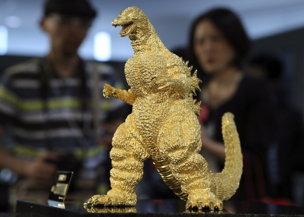 A 24-carat gold Godzilla, worth an estimated $148 million, is displayed during a press preview of the Godzilla Expo in Tokyo this month.