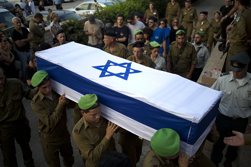 Israeli soldiers carry the coffin of 2nd Lt. Roy Peles, an infantry officer, during his funeral at Kiryat Shaul military cemetery in Tel Aviv, Israel, Sunday. The Associated Press