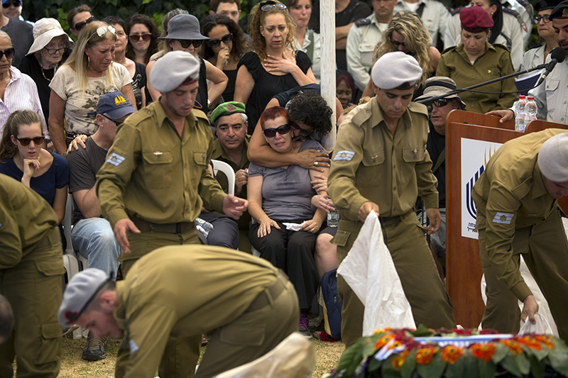 The mother of Staff Sgt. Amit Yeori, 20, cries during his funeral at the Mount Herzel military cemetery in Jerusalem, Sunday. The Associated Press