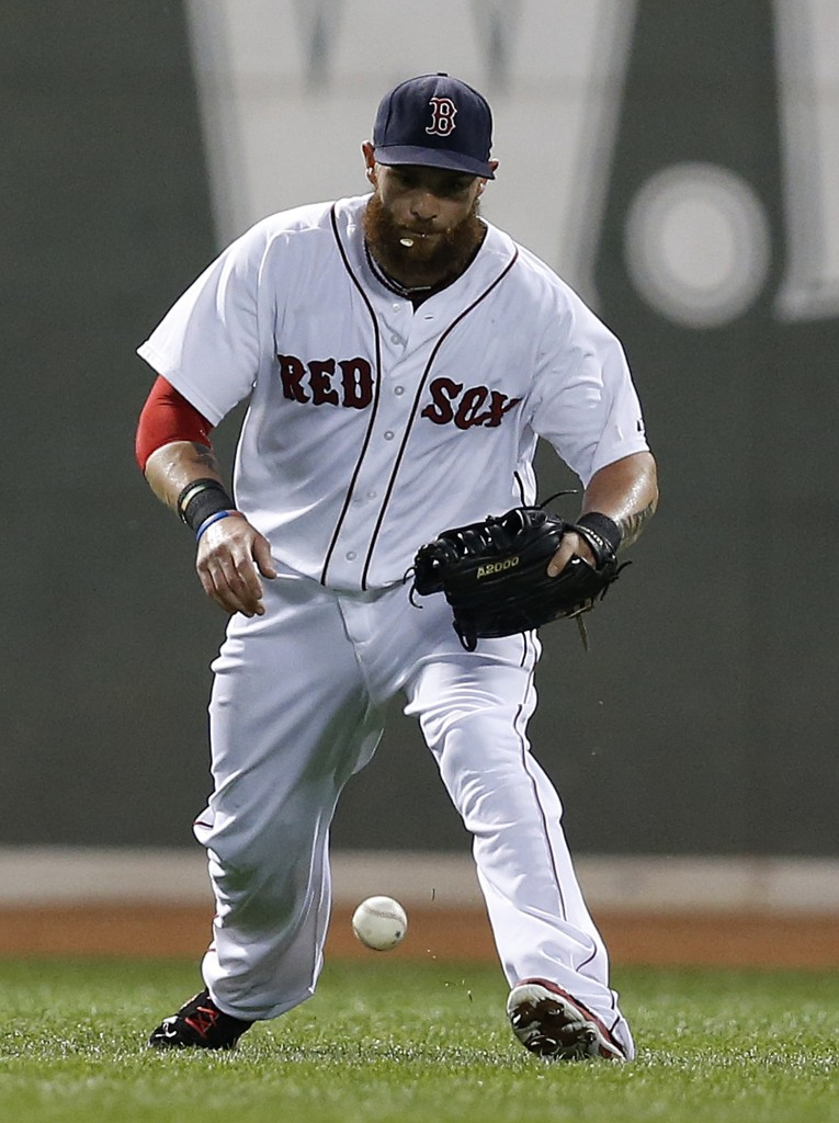 Outfielder Jonny Gomes, seen in a game at Fenway Park on  July 19, was traded to the Oakland A's on Thursday along with starting pitcher Jon Lester.