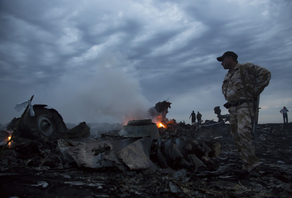 People walk amongst the debris at the crash site of the Malaysian Airlines passenger plane near the village of Grabovo, Ukraine on Thursday. The Associated Press