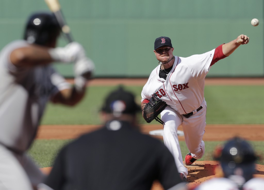 Red Sox starting pitcher Jon Lester delivers during the first inning of Thursday's  game against the Chicago White Sox at Fenway Park.